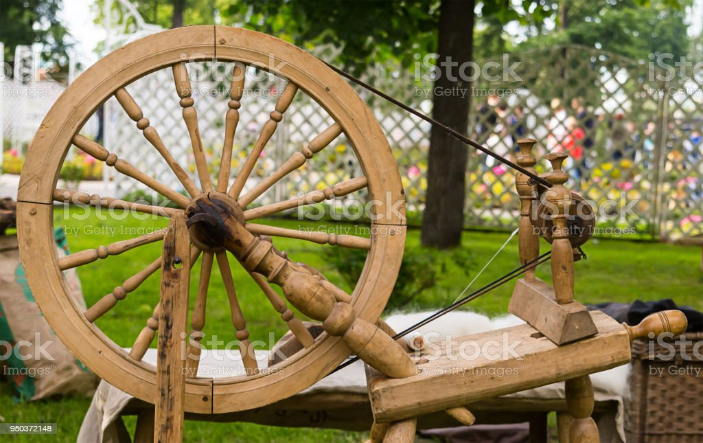 Old wooden worker spinning wheel traditional tools of seamstresses in the Middle Ages stock photo