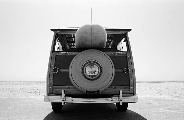 Old  Woodie Station Wagon with Surfboard​​​ foto