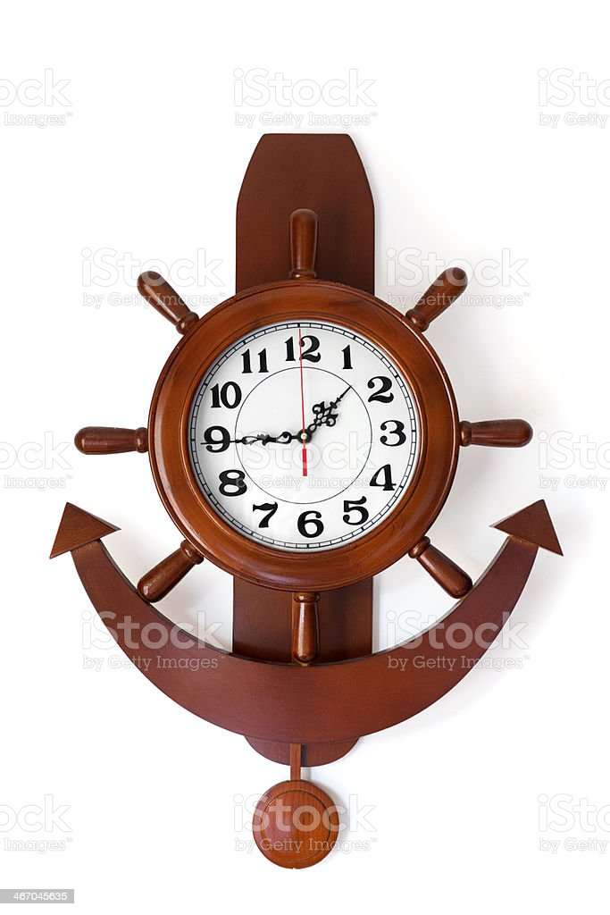 Old Woodn cruise clock on white wall stock photo