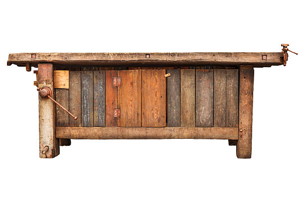 Old work bench isolated on white Old carpenter wooden work bench isolated on a white background workbench stock pictures, royalty-free photos & images