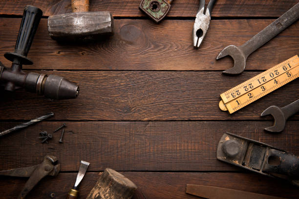 Old Work Tools on Rustic Background stock photo