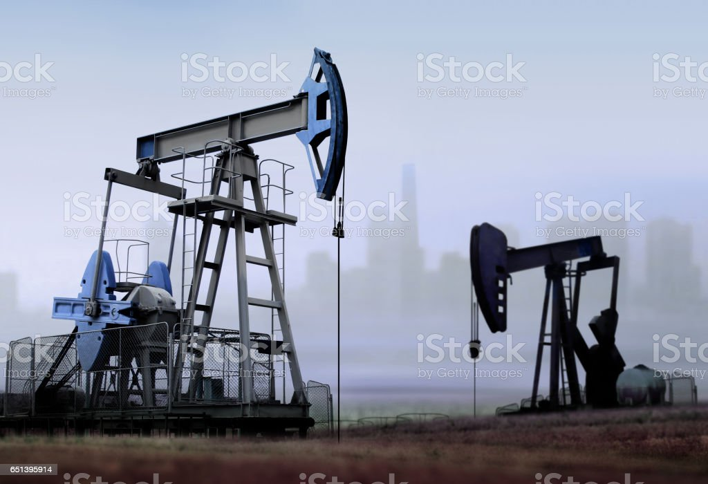 old working oil pumps stock photo