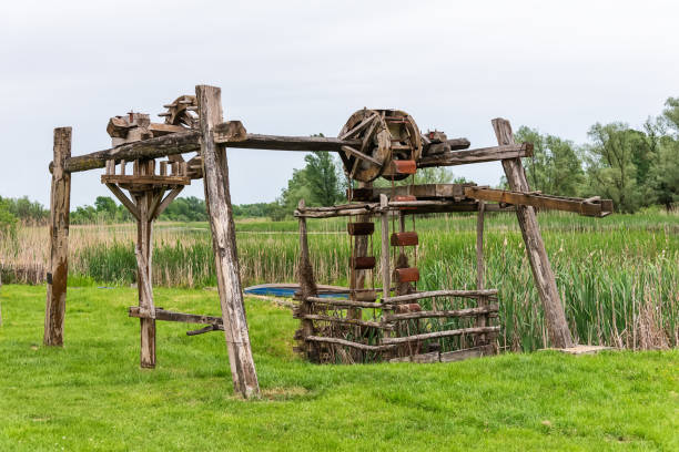 Old working sweep well and shadoof with landscape stock photo