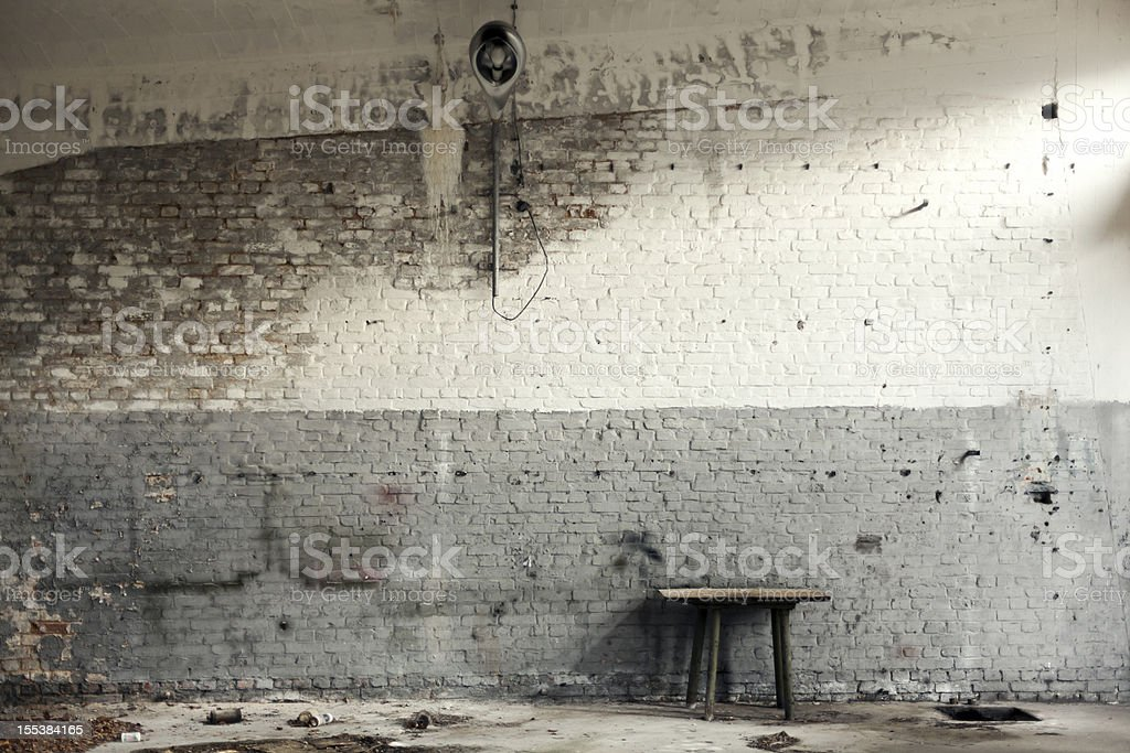 Old workshop with white and gray brick walls stock photo