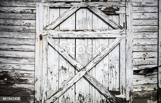 old worn and peeling barn door