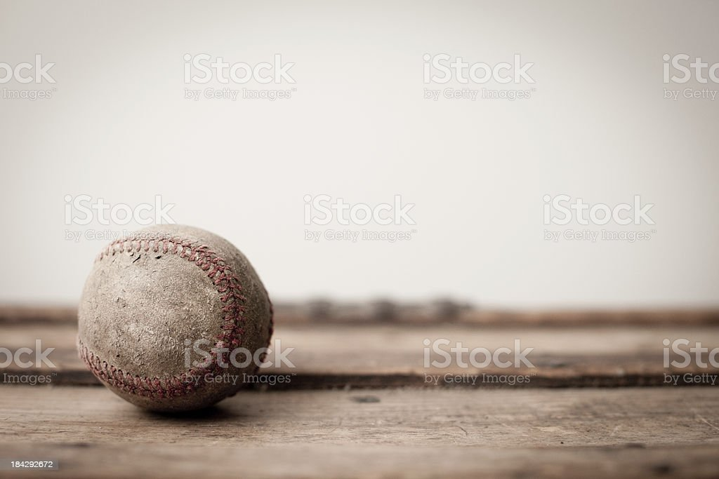 Old, Worn Baseball on Antique Wooden Trunk royalty-free stock photo