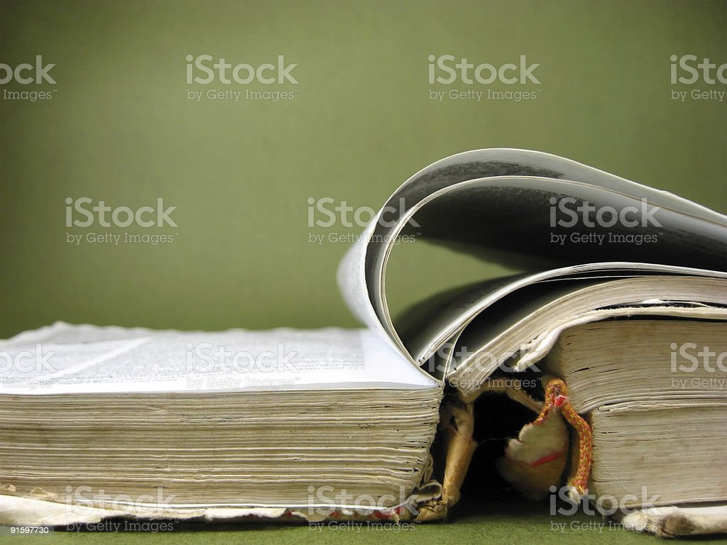 Old worn book on green royalty-free stock photo