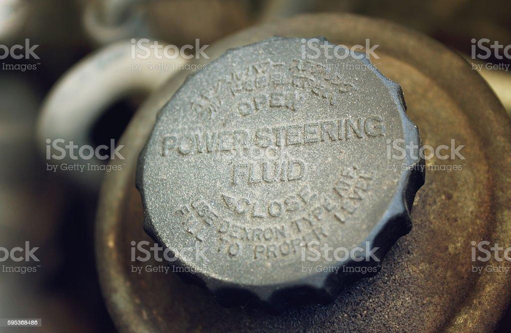 Old worn cap of power steering reservoir stock photo