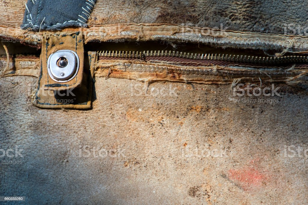 Old, worn leather jacket. A broken zipper. stock photo