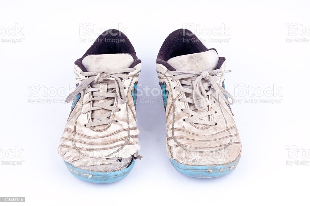 Old worn out futsal sports shoes  on white background  isolated stock photo