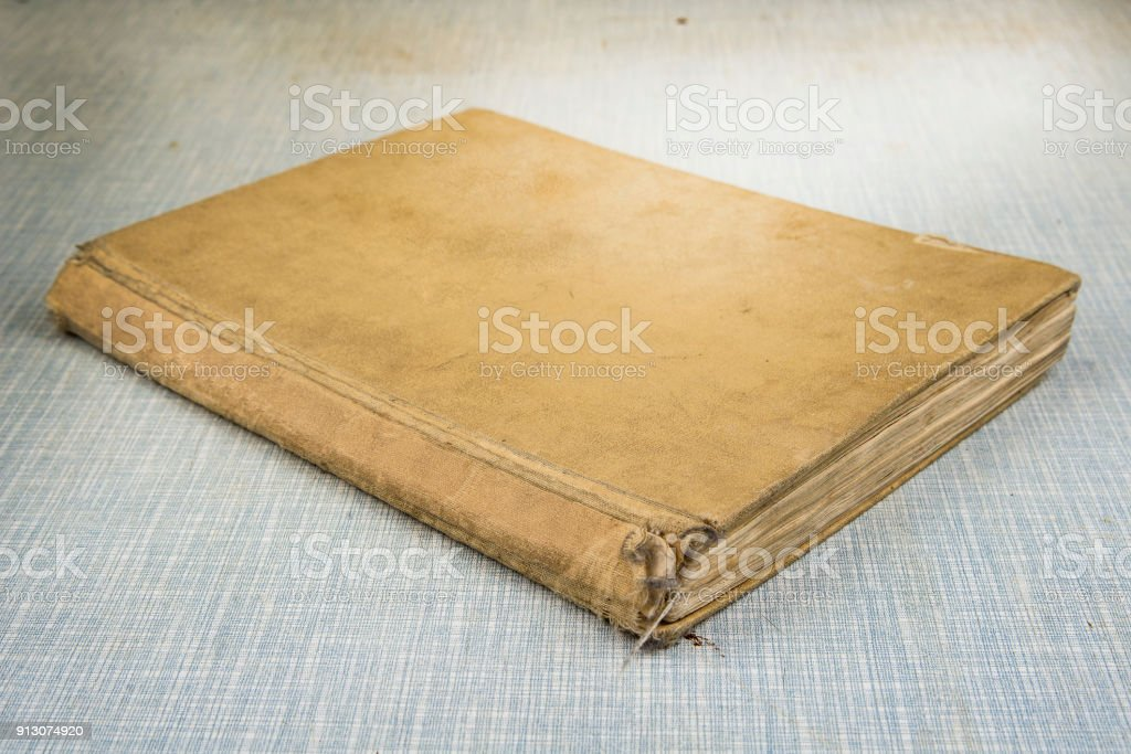 Old worn out vintage books on the table. stock photo