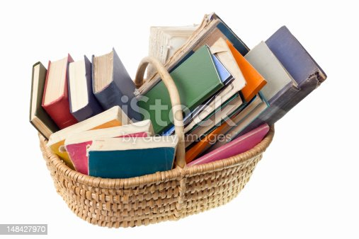 Old worn ragged books are in the basket . Books on the garbage dump concept