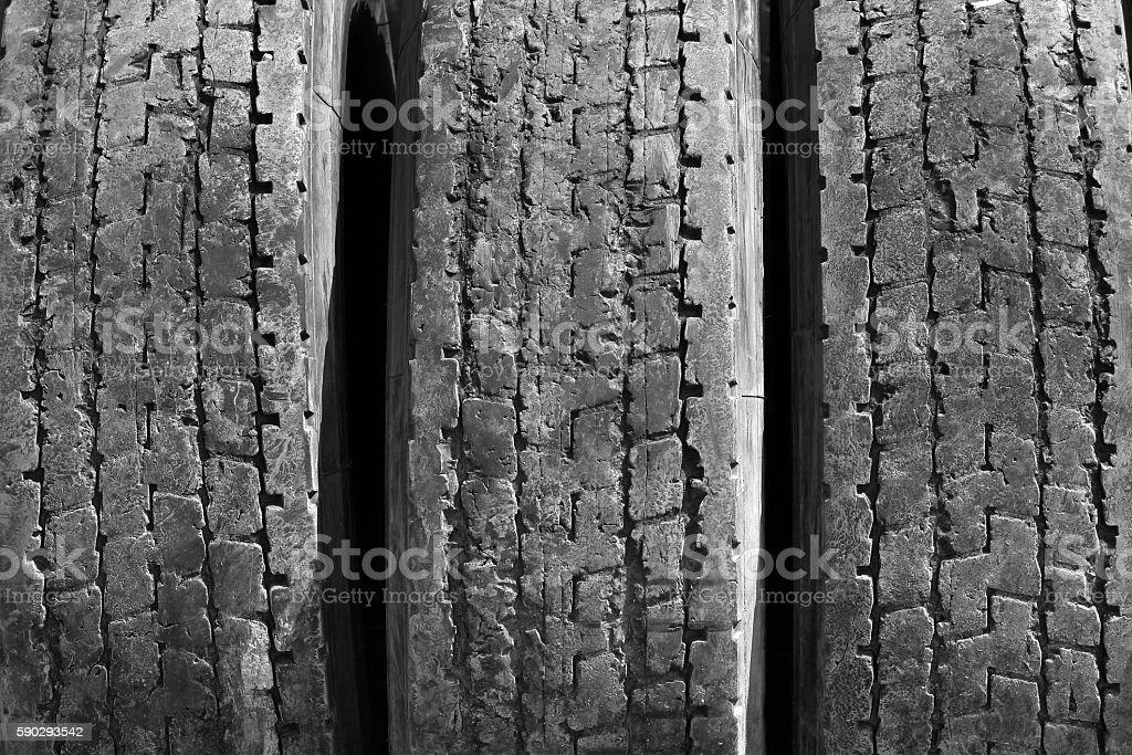 Old worn used car tires royaltyfri bildbanksbilder