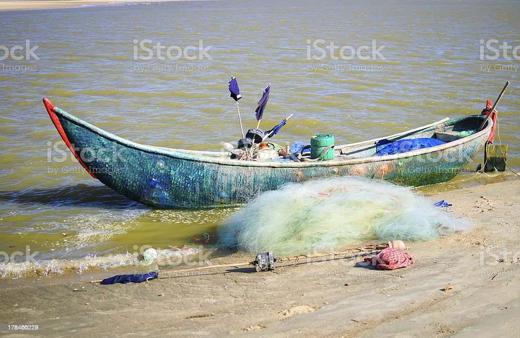 Old woven bamboo fishing boat stock photo