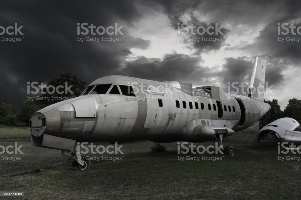 Old wreck airplane on the field stock photo