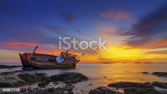 Seascape with old derelict fishing boat