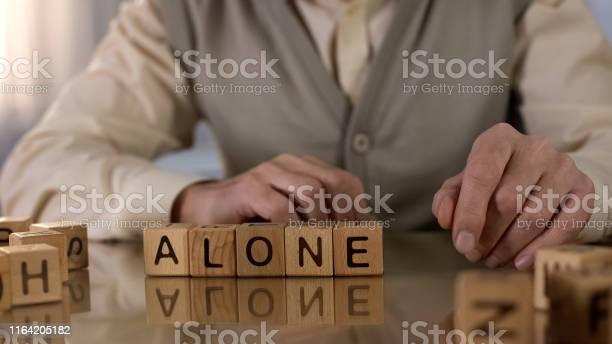 Old wrinkled male making word alone of wooden cubes on table nursing picture id1164205182?b=1&k=6&m=1164205182&s=612x612&h=agjhdw wkay4bi9qvybbhk0hasfeuipjwqx7bttpeum=