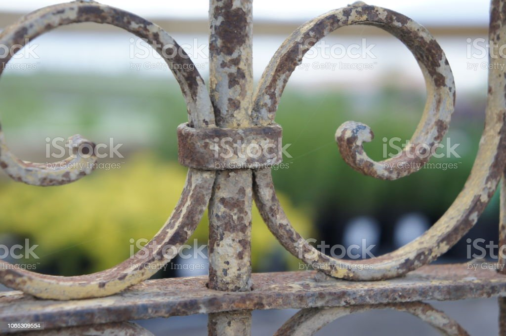 Old wrought iron fence gate door panel stock photo