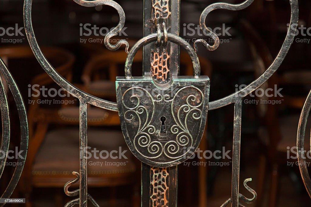 old wrought-iron lock on the door stock photo