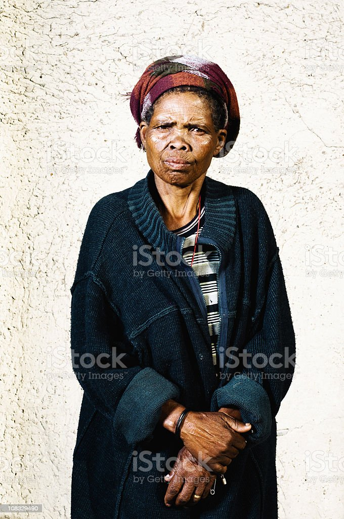 Old Xhosa woman infront of house royalty-free stock photo
