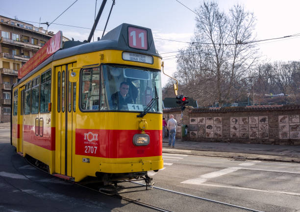 Old yellow and red tram on the streets of Belgrade stock photo