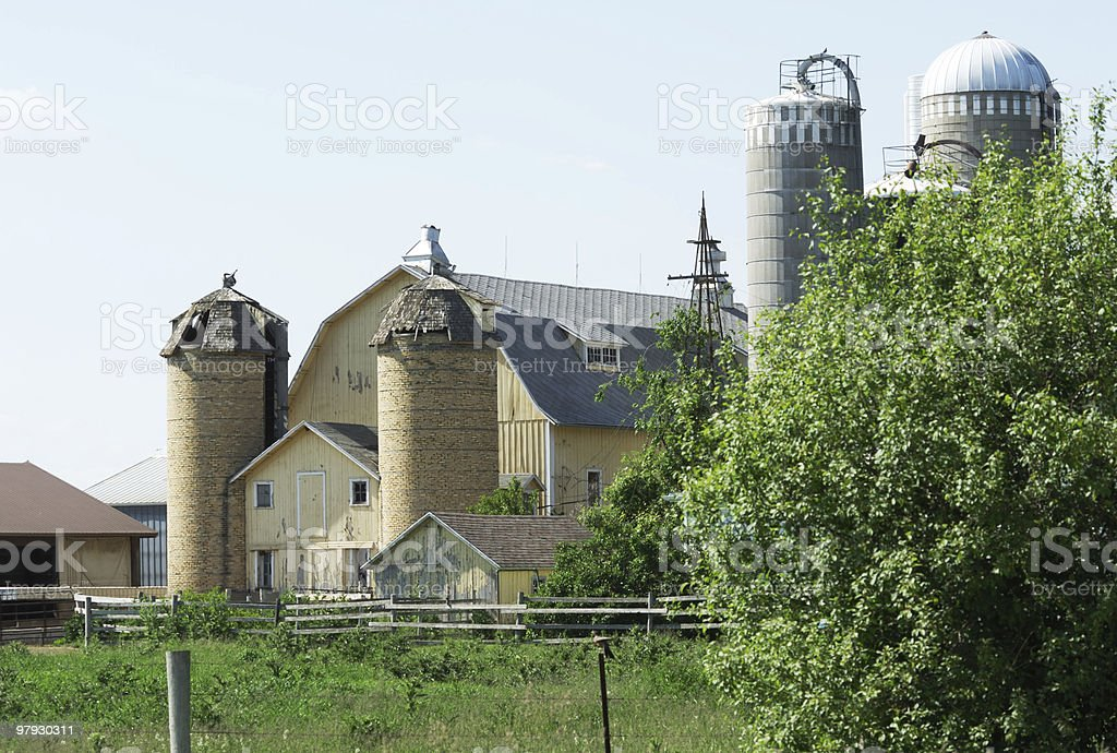 Old Yellow Barn and Silos royalty-free stock photo