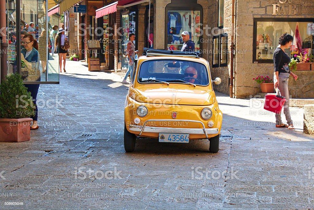Old yellow car Fiat 500 in San Marino, Italy stock photo