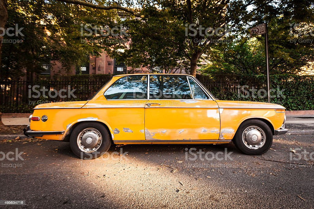 Old Yellow Car in Brooklyn stock photo