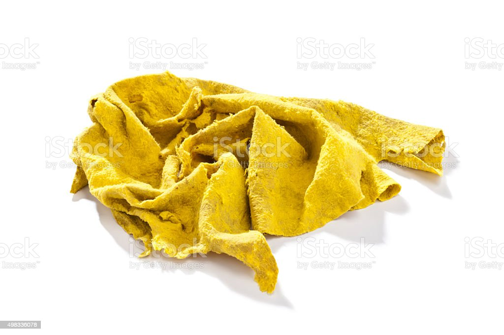 Old yellow cleaning rag stock photo