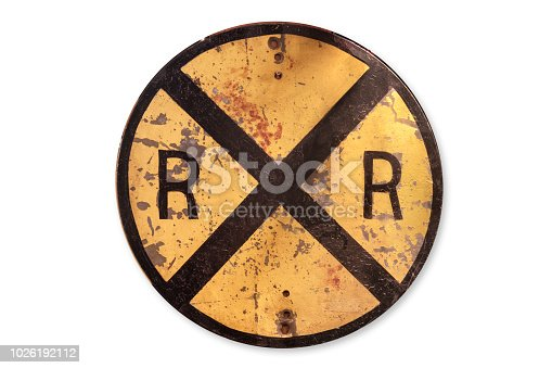 Old yellow railroad crossing sign on white background