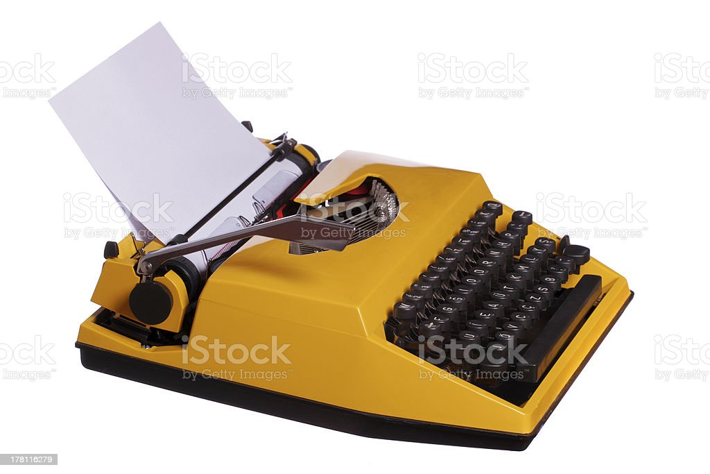 old yellow typewriter with paper royalty-free stock photo