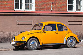 Helsinki, Finland - May 7, 2016: Old yellow Volkswagen beetle, front view