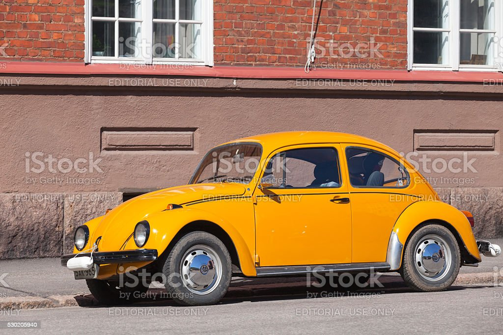 Old yellow Volkswagen beetle in the city stock photo