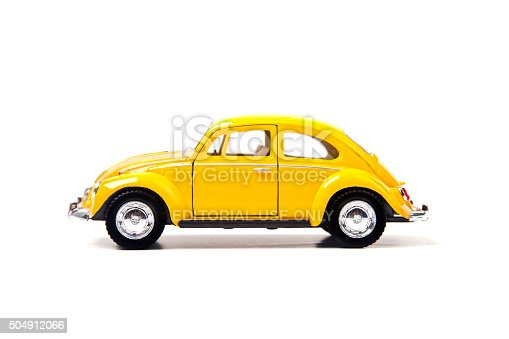 Izmir, Turkey - January 5, 2013: Vintage toy Volkswagen car close up image on isolated white background.
