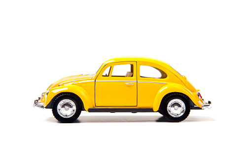 Izmir, Turkey - January 5, 2013: Vintage toy Volkswagen car close up image on isolated white background.