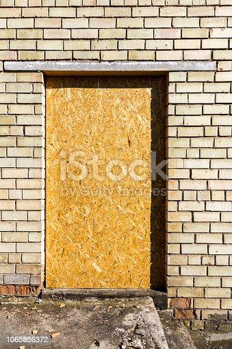 894368086 istock photo Old yellow wall 1065856372