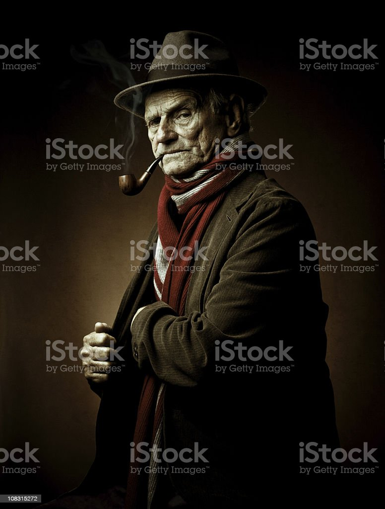 old yet dangerous man with pipe royalty-free stock photo