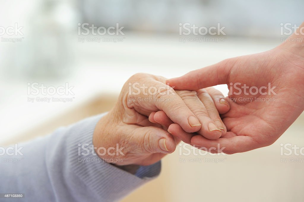 Old & Young Hands stock photo