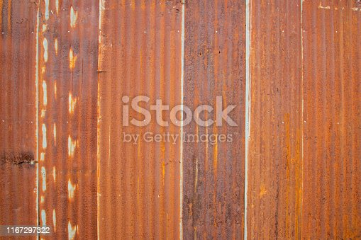 istock Old Zinc rust texture background, close up to pattern texture vertical zinc sheet. Abstract  Image of Rusty corrugated metal vintage background. Wall steel older dirty grunge surface fence house. 1167297322