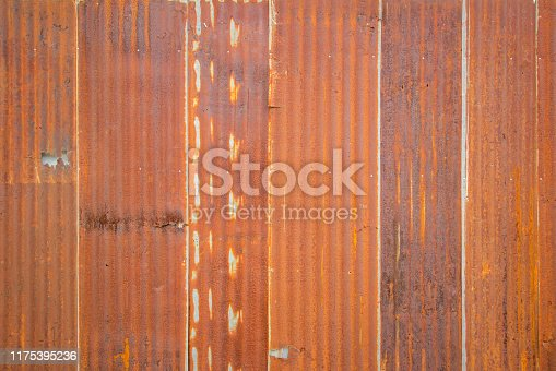 638964834istockphoto Old Zinc rust texture background, close up to pattern texture vertical zinc sheet. Abstract  Image of Rusty corrugated metal vintage background view. Wall steel older dirty grunge. 1175395236