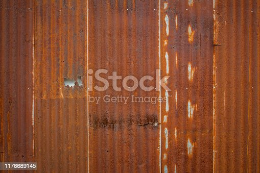 638964834istockphoto Old Zinc rust texture background, close up to pattern texture vertical zinc sheet. Abstract  Image of Rusty corrugated metal vintage background view. Wall steel older dirty grunge. 1176689145