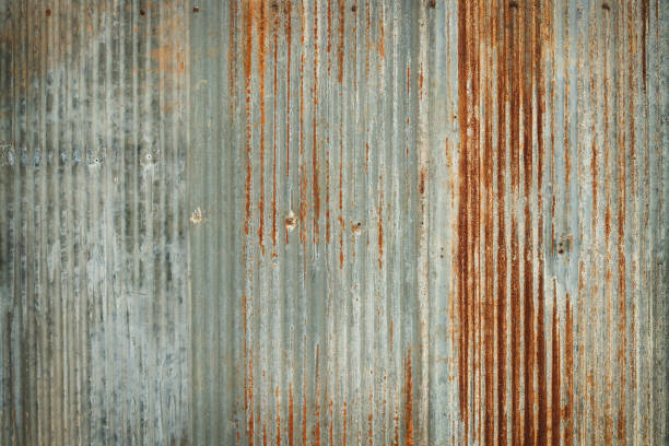 old zinc wall texture background, rusty on galvanized metal panel sheeting. - enferrujado imagens e fotografias de stock