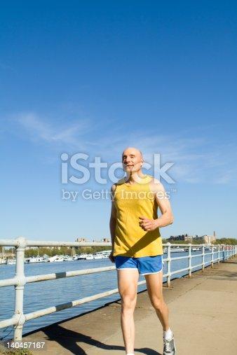 Senior running along side a river  - See lightbox for more