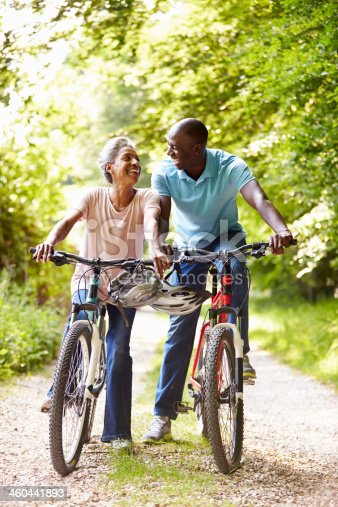 istock Older African-American could riding bicycles on narrow lane 460441893