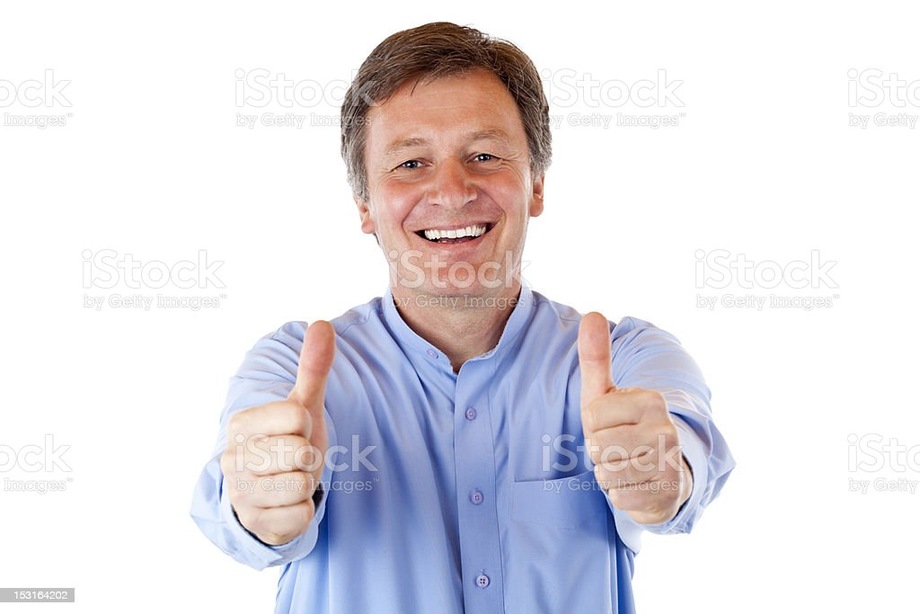 Older, attractive, happy smiling senior man shows both thumbs up royalty-free stock photo
