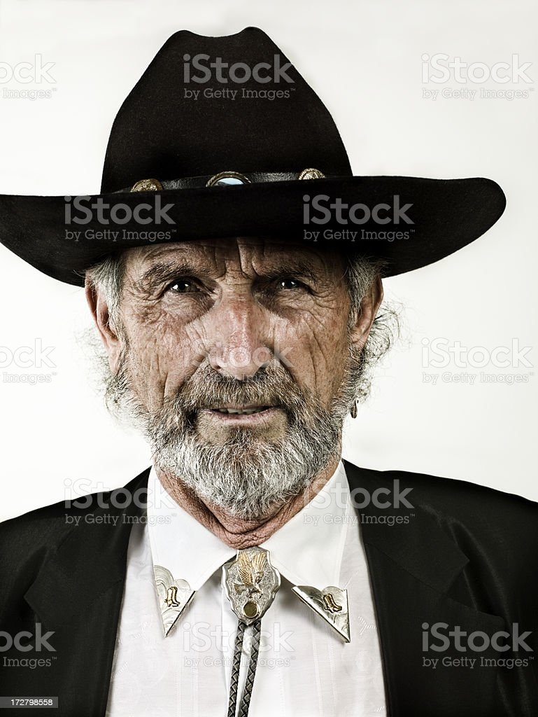 Older attractive man with cowboy hat stock photo