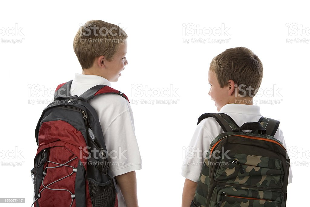 Older brother talking to younger brother before school royalty-free stock photo
