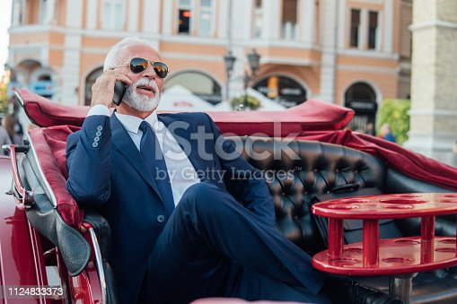 Senior business man using mobile phone
