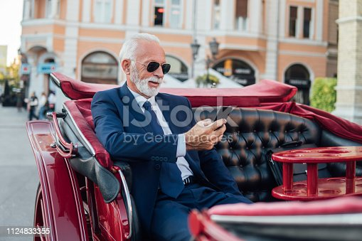 Senior business man looking at mobile phone