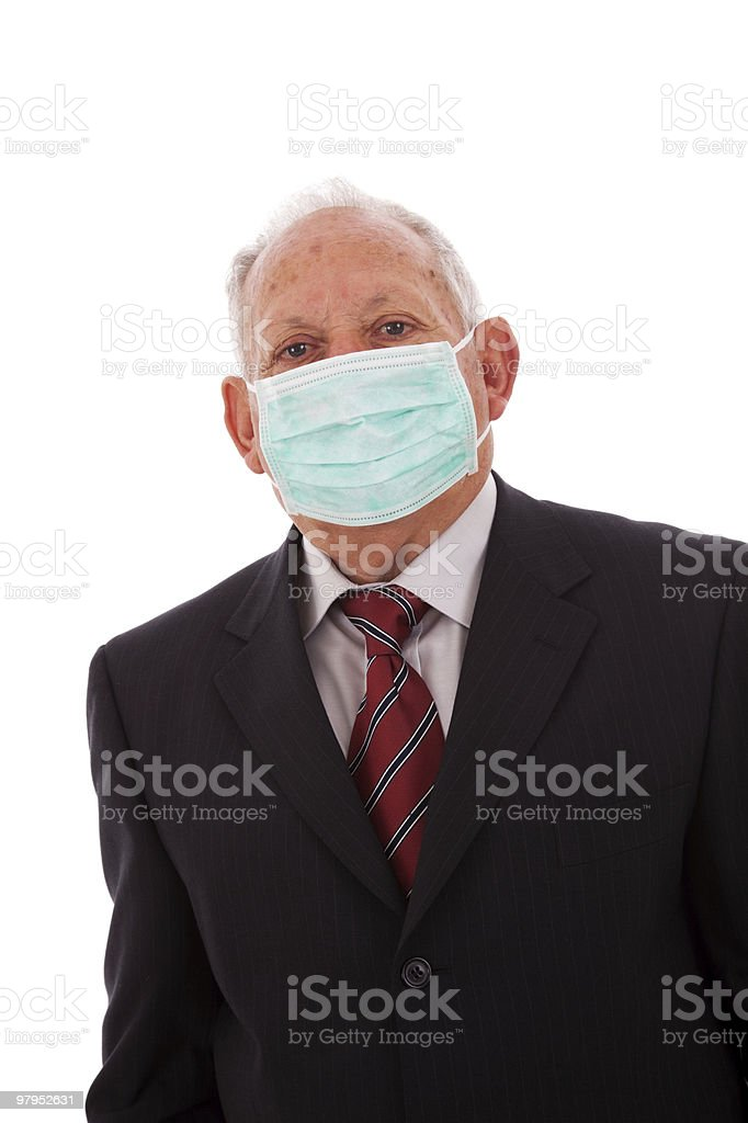Older businessman with a mask royalty-free stock photo